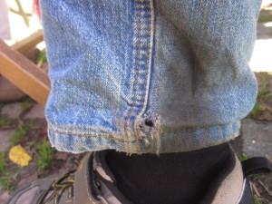 Verschleiß durch nicht montierten Kettenschutz an normal langer Jeans